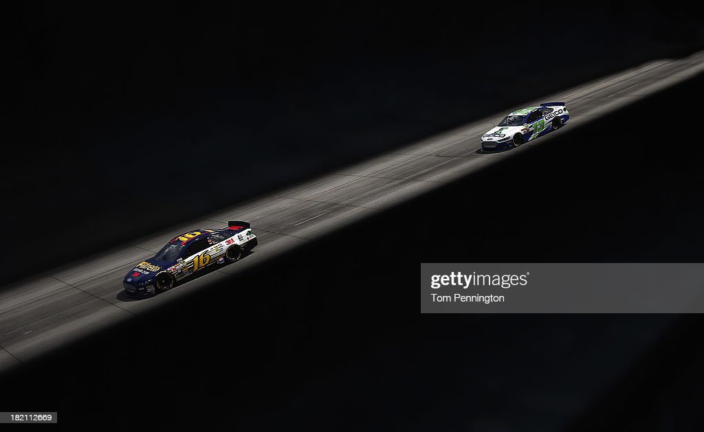 Greg Biffle, driver of the #16 Filtrete Ford, leads Casey Mears, driver of the #13 GEICO Ford, during practice for the NASCAR Sprint Cup Series AAA 400 at Dover International Speedway on September 28, 2013 in Dover, Delaware.