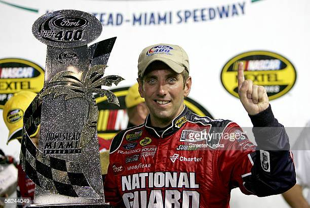 Greg Biffle driver of the National Guard Ford celebrates after winning the NASCAR Nextel Cup Series Ford 400 on November 20 2005 at HomesteadMiami...