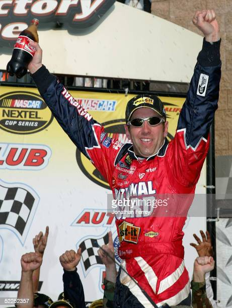 Greg Biffle driver of the PostIt Ford celebrates in victory lane during the NASCAR Nextel Cup Auto Club 500 on February 27 2005 at California...