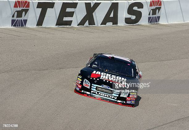 Greg Biffle drives his Jackson Hewitt Ford during practice for the NASCAR Nextel Cup Series Dickies 500 at Texas Motor Speedway on November 2 2007 in...