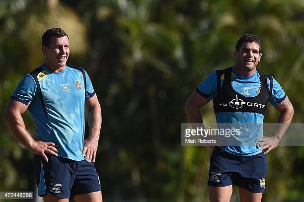 Greg Bird and Beau Falloon smile during a Gold Coast Titans NRL training session on May 8 2015 on the Gold Coast Australia