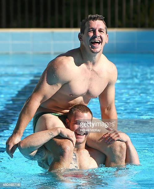 Greg Bird and Trent Merrin joke around in the pool during a New South Wales Blues State of Origin training session at Novotel Coffs Harbour on June...