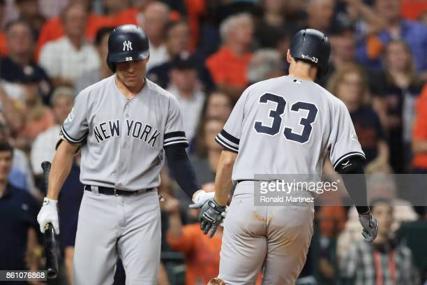 Greg Bird celebrates his solo homerun with Jacoby Ellsbury of the New York Yankees in the ninth inning against the Houston Astros during game one of...