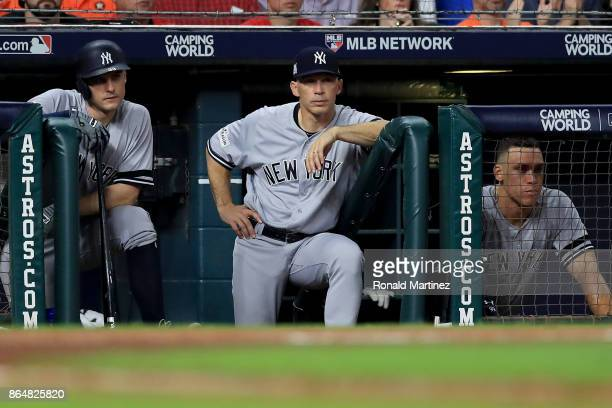Greg Bird, manager Joe Girardi and Aaron Judge of the New York Yankees look on from the dugout during the sixth inning against the Houston Astros in...