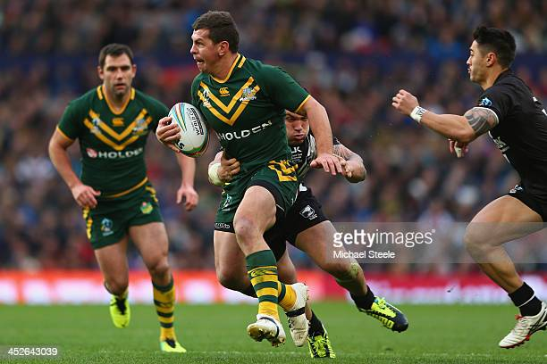 Greg Bird of Australia is held up by Jared WaereaHargreaves of New Zealand during the Rugby League World Cup Final between Australia and New Zealand...