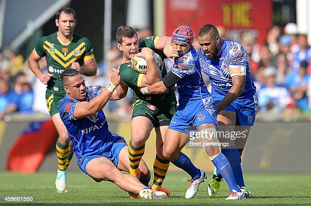 Greg Bird of Australia is tackled during the Four Nations match between the Australian Kangaroos and Samoa at WIN Stadium on November 9 2014 in...