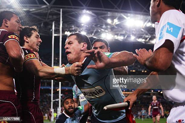 Greg Bird of the Blues fights with Maroons players during game three of the ARL State of Origin series between the New South Wales Blues and the...