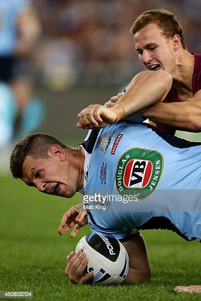 Greg Bird of the Blues is tackled during game two of the State of Origin series between the New South Wales Blues and the Queensland Maroons at ANZ...