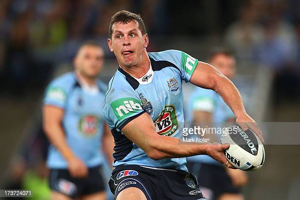 Greg Bird of the Blues runs the ball during game three of the ARL State of Origin series between the New South Wales Blues and the Queensland Maroons...