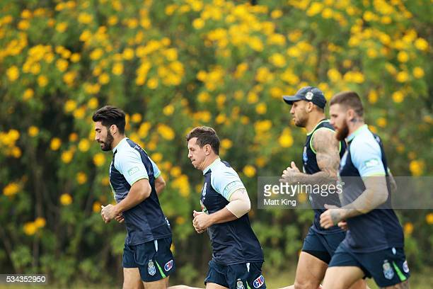 Greg Bird of the Blues runs with team mates during a New South Wales State of Origin media opportunity on May 26 2016 in Coffs Harbour Australia