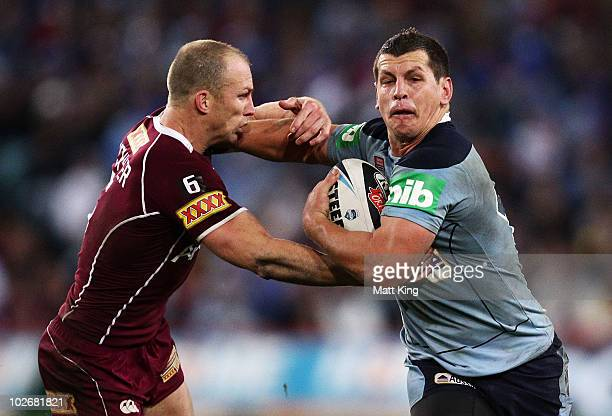 Greg Bird of the Blues tries to fend off Darren Lockyer of the Maroons during game three of the ARL State of Origin series between the New South...