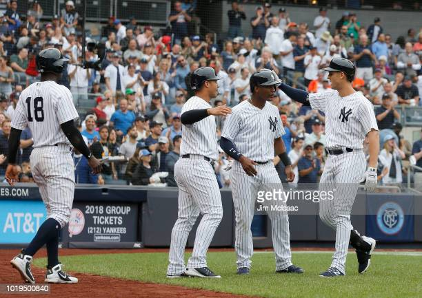 Greg Bird of the New York Yankees celebrates his first inning grand slam home run against the Toronto Blue Jays with teammates Didi Gregorius Gleyber...