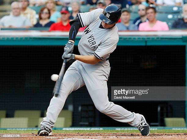 Greg Bird of the New York Yankees flies out to right field in his first at bat in his major league debut against the Cleveland Indians during the...