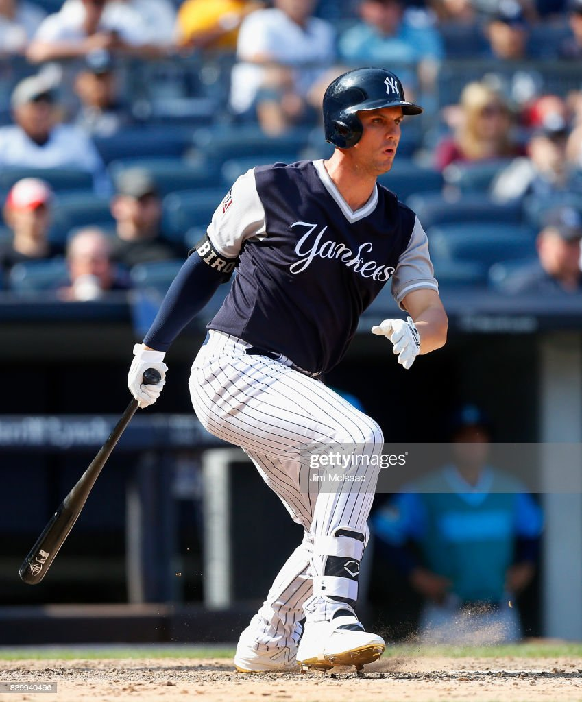 Greg Bird #33 of the New York Yankees follows through on a seventh inning two run single against the Seattle Mariners at Yankee Stadium on August 27, 2017 in the Bronx borough of New York City.
