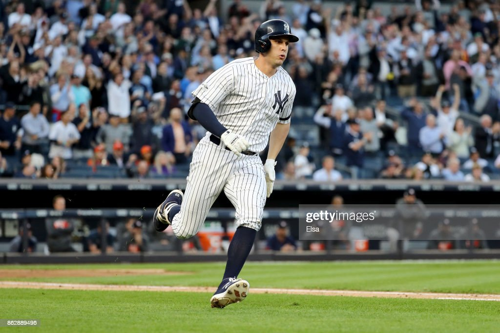 Greg Bird #33 of the New York Yankees hits a single during the second inning scoring Starlin Castro #14 against the Houston Astros in Game Five of the American League Championship Series at Yankee Stadium on October 18, 2017 in the Bronx borough of New York City.