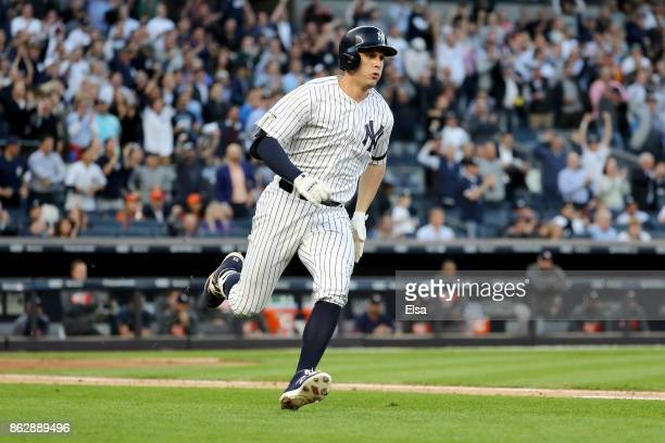 Greg Bird of the New York Yankees hits a single during the second inning scoring Starlin Castro against the Houston Astros in Game Five of the...