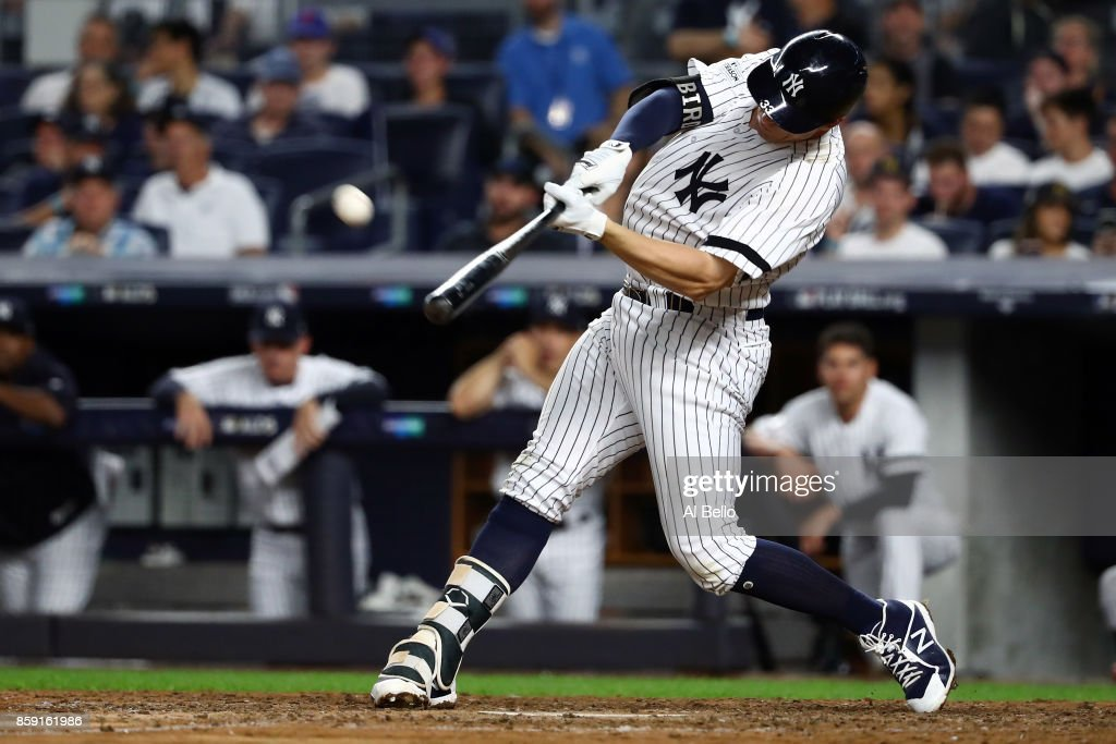 Greg Bird #33 of the New York Yankees hits a solo-homerun during the seventh inning against the Cleveland Indians in game three of the American League Division Series at Yankee Stadium on October 8, 2017 in New York City.