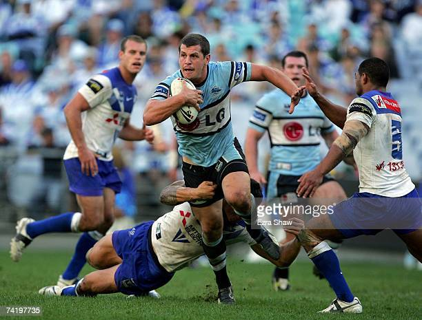 Greg Bird of the Sharks runs away from the Bulldogs defence during the round 10 NRL match between the Bulldogs and the CronullaSutherland Sharks at...
