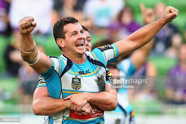 Greg Bird of the Titans celebrates kicking a goal from a penalty to win the match the round five NRL match between the Melbourne Storm and the Gold...