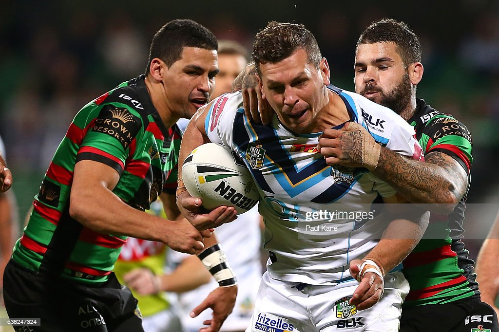 Greg Bird of the Titans gets tackled by Adam Reynolds of the Rabbitohs during the round 13 NRL match between the South Sydney Rabbitohs and the Gold Coast Titans at nib Stadium on June 5, 2016 in Perth, Australia.