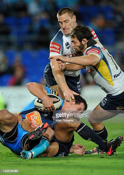 Greg Bird of the Titans is tackled during the round 13 NRL match between the Gold Coast Titans and the North Queensland Cowboys at Skilled Park on...