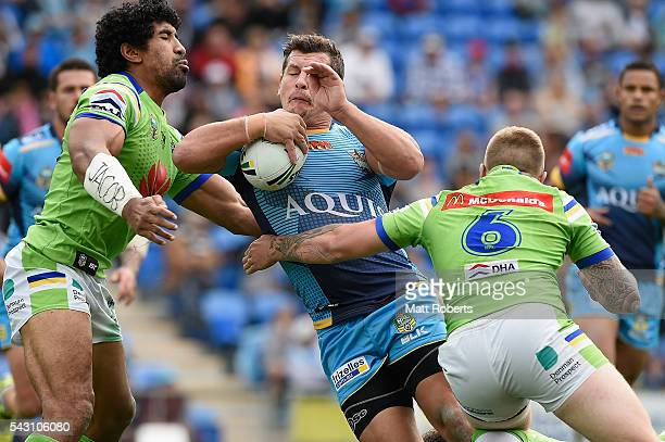 Greg Bird of the Titans is tackled during the round 16 NRL match between the Gold Coast Titans and the Canberra Raiders at Cbus Super Stadium on June...