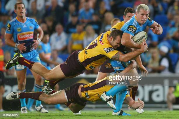 Greg Bird of the Titans is tackled during the round five NRL match between the Gold Coast Titans and the Brisbane Broncos at Skilled Park on April 5...
