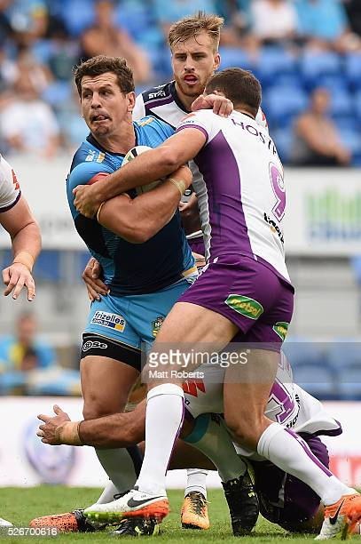 Greg Bird of the Titans is tackled during the round nine NRL match between the Gold Coast Titans and the Melbourne Storm on May 1 2016 in Gold Coast...