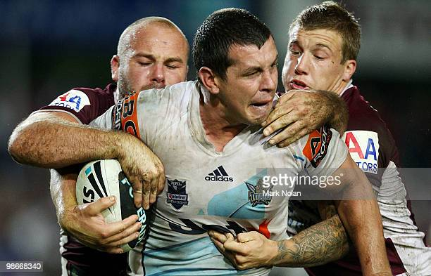 Greg Bird of the Titans is tackled during the round seven NRL match between the Manly Sea Eagles and the Gold Coast Titans at Brookvale Oval on April...