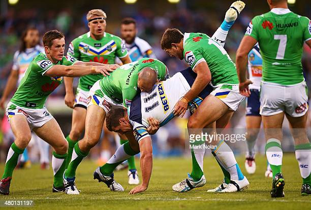 Greg Bird of the Titans is up ended during the round three NRL match between the Canberra Raiders and the Gold Coast Titans at GIO Stadium on March...