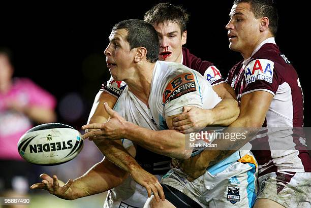 Greg Bird of the Titans offloads during the round seven NRL match between the Manly Sea Eagles and the Gold Coast Titans at Brookvale Oval on April...