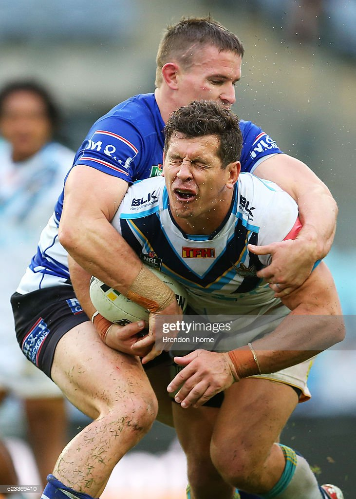 Greg Bird of the Titans receives a high tackle from Tim Browne of the Bulldogs during the round eight NRL match between the Canterbury Bulldogs and the Gold Coast Titans at ANZ Stadium on April 23, 2016 in Sydney, Australia.