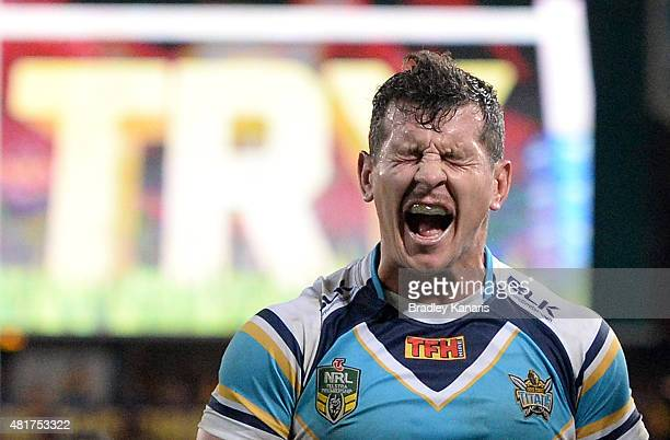 Greg Bird of the Titans shows his disappointment after Alex Glenn of the Broncos scores a try during the round 20 NRL match between the Brisbane...