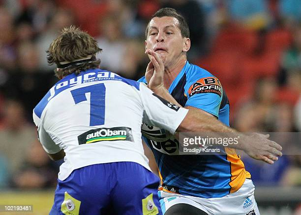 Greg Bird of the Titans takes on the defence of Brett Kimmorley of the Bulldogs during the round 15 NRL match between the Canterbury Bulldogs and the...