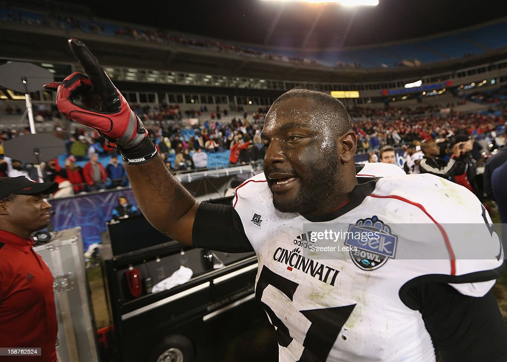 Greg Blair #51 of the Cincinnati Bearcats celebrates after defeating the Duke Blue Devils 48-34 after their game at Bank of America Stadium on December 27, 2012 in Charlotte, North Carolina.