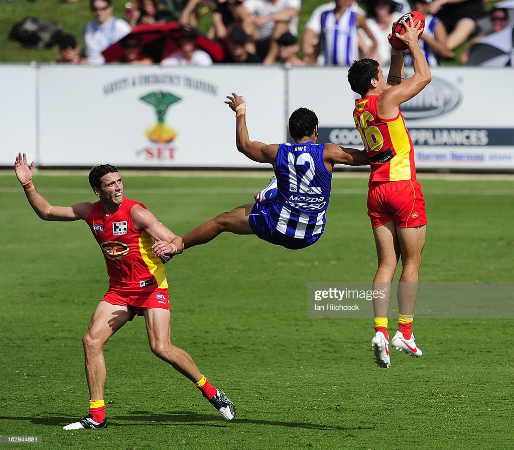 Greg Broughton of the Suns takes a mark ahead of Lindsay Thomas of the Kangaroos during the round two AFL NAB Cup match between the Gold Coast Suns and the North Melbourne Kangaroos at Tony Ireland Stadium on March 2, 2013 in Townsville, Australia.