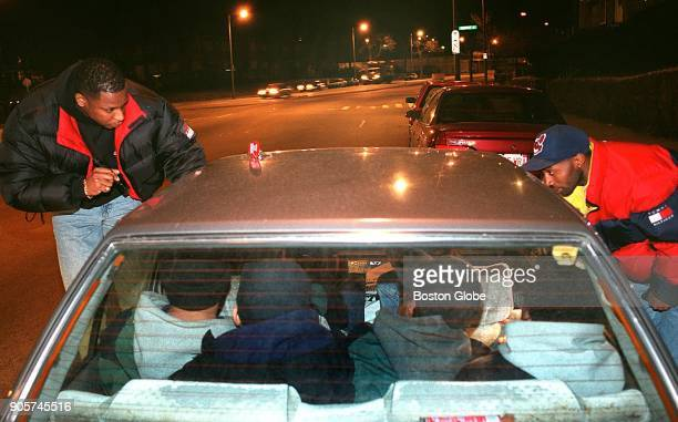 Greg Brown left and Craig Jones Boston Police officers with the Youth Violence Strike Force pull over and search a car crammed with six teenagers...