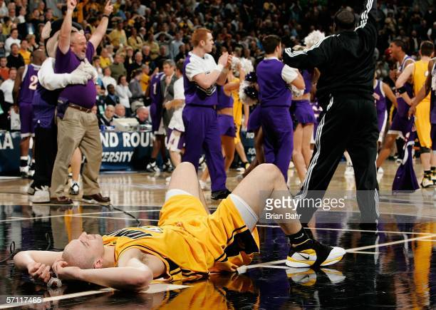 Greg Brunner of the Iowa Hawkeyes lies on the court after the Northwestern State Demons 6463 upset win during the First Round of the 2006 NCAA Men's...