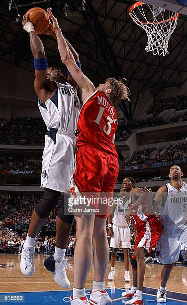 Greg Buckner of the Dallas Mavericks is blocked by Hanno Mottola of the Atlanta Hawks at the American Airlines Center in Dallas Texas DIGITAL IMAGE...