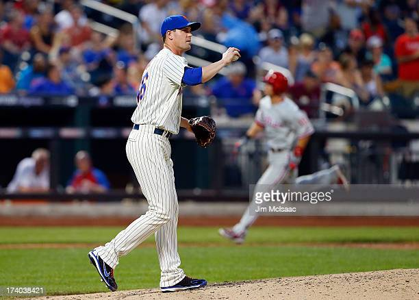 Greg Burke of the New York Mets reacts after surrendering a thirdinning threerun home run against Michael Young of the Philadelphia Phillies at Citi...