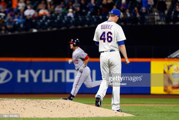 Greg Burke of the New York Mets stands on the mound after surrendering a fifth inning threerun home run against Wilson Ramos of the Washington...