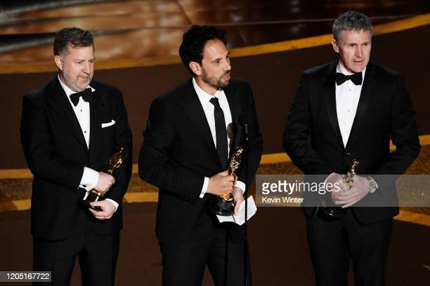 Greg Butler, Guillaume Rocheron, and Dominic Tuohy accept the Visual Effects award for '1917' onstage during the 92nd Annual Academy Awards at Dolby...