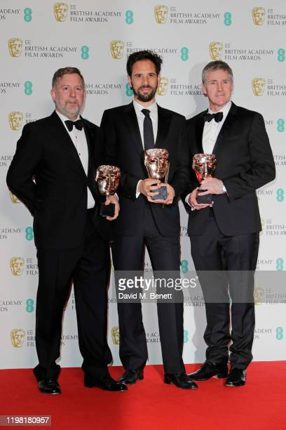 """Greg Butler, Guillaume Rocheron and Dominic Tuohy, winners of the Best Special Visual Effects for """"1917"""", pose in the Winners Room at the EE British..."""