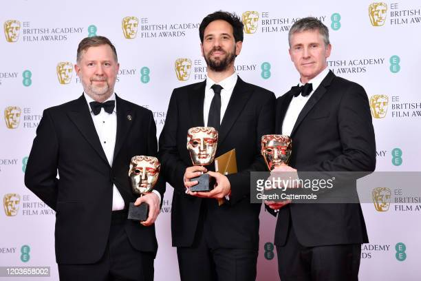 """Greg Butler, Guillaume Rocheron and Dominic Tuohy, winners of the Best Special Visual Effects for """"1917"""", pose in the Winners Room during the EE..."""