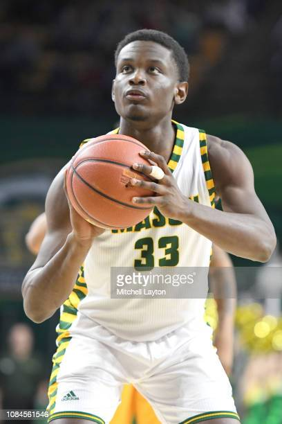 Greg Calixte of the George Mason Patriots takes a foul shot during a college basketball game against the Southern University Jaguars at the Eagle...