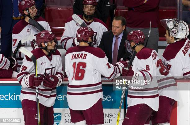 Greg Carvel head coach of the Massachusetts Minutemen talks to Cale Makar during NCAA hockey at the Mullins Center on November 9 2017 in Amherst...