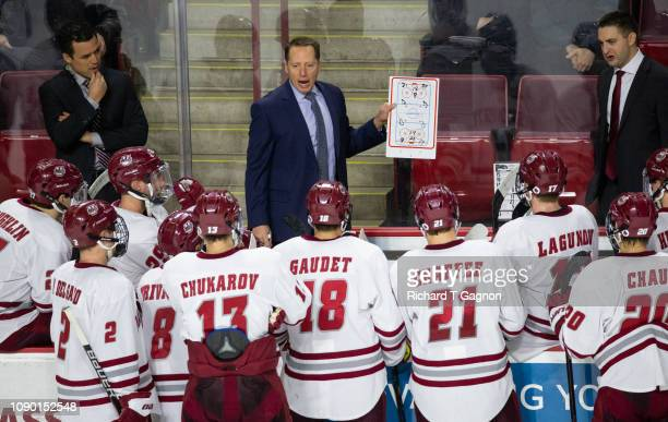 Greg Carvel head coach of the Massachusetts Minutemen talks to his team during a game against the Massachusetts Lowell River Hawks during NCAA hockey...