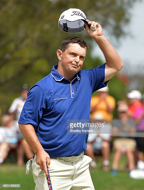 Greg Chalmers of Australia celebrates after he sinks a putt on the 18th hole to take the lead during day four of the 2014 Australian PGA Championship...
