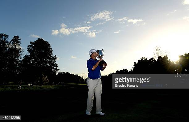 Greg Chalmers of Australia celebrates as he holds up the Kirkwood Cup after day four of the 2014 Australian PGA Championship at Royal Pines Resort on...