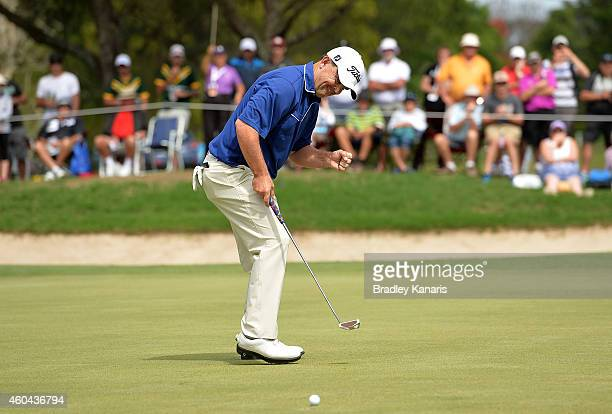 Greg Chalmers of Australia celebrates as he sinks a putt on the 18th hole to take the lead during day four of the 2014 Australian PGA Championship at...
